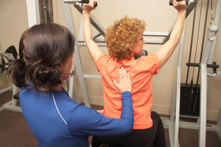 A trainer providing close supervision of exercise repetition speed