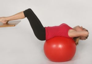 Eccentric crunch as a corrective exercise to lengthen the abs as part of an effective abdominal training routine.